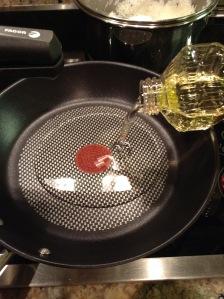 Add Canola Oil in Frying Pan